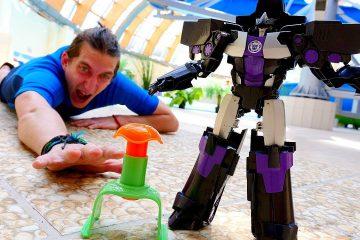 Roboty-Transformery-Megatron-ili-Optimus-Video-shou-Akvatim