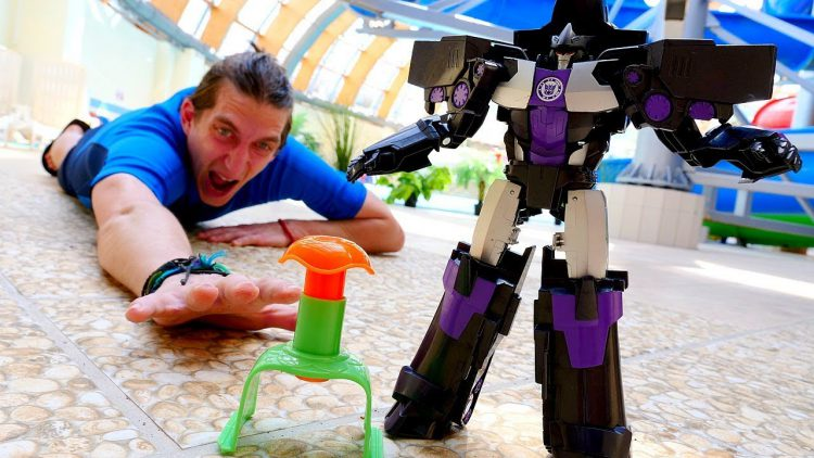 Roboty-Transformery-Megatron-ili-Optimus-Video-shou-Akvatim