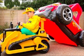 Max-and-Katy-playing-with-Ride-on-Toy-Cars-and-Carriege