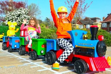 Katy-and-Max-build-railway-for-kids-ride-on-train