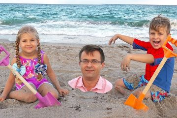 Diana-and-Roma-play-with-Dad-on-the-Beach