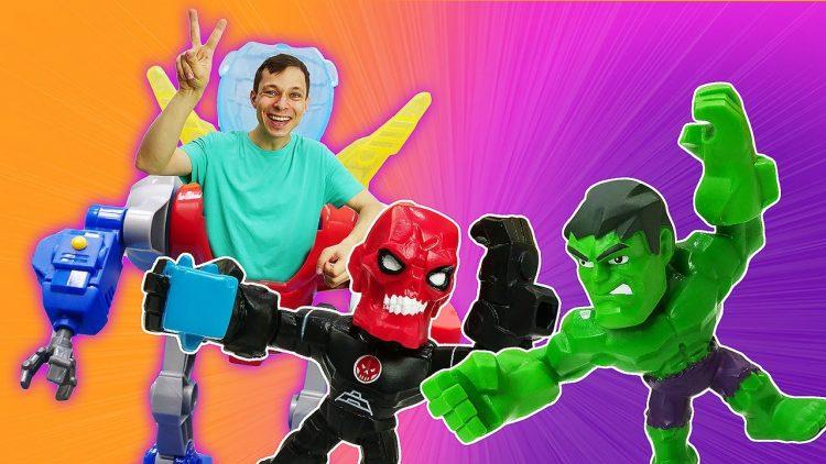 Video-igry-Supergeroi-i-Roboty-v-Avtomasterskoj-Prokachivaem-mashinu-Halka-i-sobiraem-Dinozavra