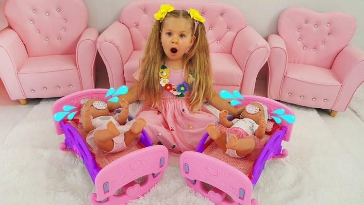 Diana-pretend-babysitting-cry-baby-dolls